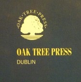 Image of the Oak Tree Press logo on a management book