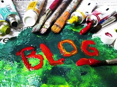 The word BLOG written in oil paints